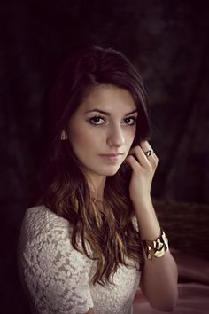 beautiful model with long brown hair and brown eyes.  lovely portrait pose