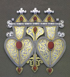 Central Asia (Turkmen) | Silver gilt and carnelian back ornament | Early 20th century | This back ornament of double heart form, sometimes worn on the breast, protects against the evil eye.