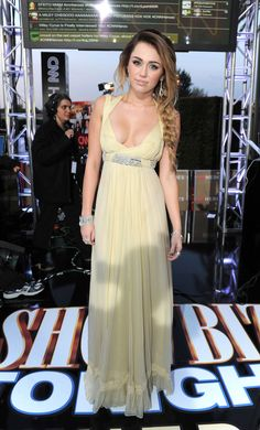 Miley Cyrus' Red Carpet Style EvolutionShowing some cleavage, Miley wore a stunning yellow dress to the 2011 CNN Heroes: An All-Star Tribute in LA. Photo: Getty Images