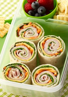 Make your own pinwheels at home — all you need is turkey, cream cheese, Deli American, carrots, spinach and a tortilla.