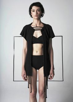 Alexandra Groover: Unisex sleeveless top features a three drawstring closure which feeds through front opening and across the chest. Drawstrings can be ruched to crea...