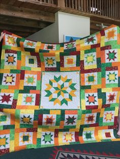 #carpenters wheel #star quilt #green red yellow orange #Lucky Stars by # Atkinson designs