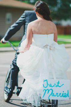 bride + groom bicycle ride // photo by June Cochran // View more: http://ruffledblog.com/colorado-country-wedding/