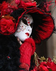 Woman in mask and red hat