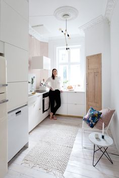Gravity Home: Bright kitchen with a pink wall