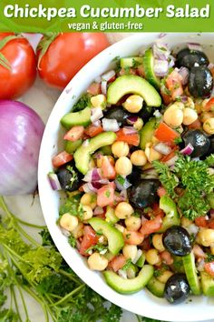 Chickpea Cucumber Salad combines some of my favorite healthy ingredients in a flavorful light dressing. It's vegan, gluten free, and perfect as a side dish or lunch or for bringing to potlucks! #chickpeas #cucumber #salad #olivews #tomatoes #healthy #vegan #glutenfree #Mediterranean #lunch #potluck