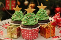 These festive Christmas tree cupcakes combine a rich chocolate sponge, a minty bright green buttercream and a sweet star to make some tasty Christmas cupcakes. The light Swiss meringue buttercream, made with mint flavouring and green food colouring, can be easily piped to resemble a tree then all you have to do is decorate as you wish. Practise your piping skills on a clean surface or plate before piping onto the cakes so you can get the effect right. Always have the same decorations?…