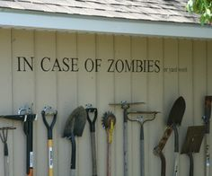 Storing garden tools with style (aka Zombiewall). My hubby just might let me do this. :o)