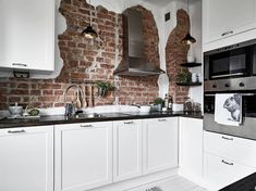 Brick wall in the kitchen bringing rough details