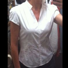 Express small white top Express design studio size small. Short sleeve white button dress or work top. Express Tops