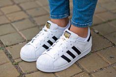 Adidas jacket  dark blue Adidas shirt  white adidas superstars  shorts