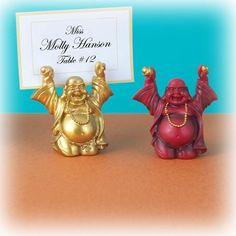 """Made out of resin, our Buddha Place Card Holders will be a huge hit at your party, event or wedding reception. Each Buddha Placecard Holder measures approx 3""""H x 2""""W and is available in Cinnabar (Dark Red) and Gold. Each placecard holder is hand painted and is extremely detailed. Your Guests will adore taking one home.    Sold in a Set of 12 (Each set must be 12 pc of the same color)  #weddingfavors #buddha #placecards"""