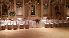 35 person head table with low centerpiece, so you can see bride and groom. Hotel DuPont Gold ballroon