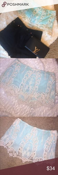 Blue and White Strapless Lace Crop Top Light blue and white crochet / lace strapless Crop Top worn once!!! In perfect condition and is absolutely stunning. Perfect for a night out. It reminds me of Princess Jasmine 🐯 Tops Crop Tops