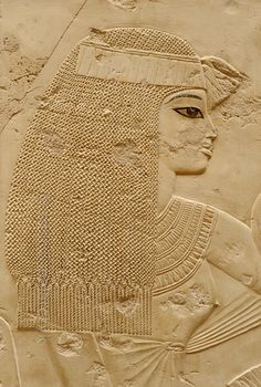 ( see the likness with Tiye from the previous relief, this is from late Amenhotep II era)Guest at funeral banquet in Ramose's tomb at Luxor.'