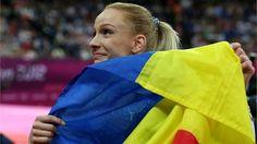 Sandra Raluca Izbasa of Romania reacts after winning Women's Vault