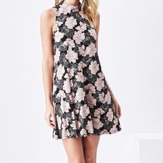 🎉ONE LEFT (XS) Floral Dress Lightweight mini dress with high collar and pretty back detail with button closure. Very flowy and roomy in the hips. Great dress, (it also machine washes very well)! Unlined but not sheer. I wear mine with leggings. I wear a small and I am a size 6. Smoke-free home. 95% Rayon, 5% Span. *📷 photo used with permission from Sadie and Sage* Sadie & Sage Dresses Mini