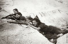 Girl snipers, fighting for the government, during the Spanish Civil War. (Photo by Keystone/Getty Images). 1936