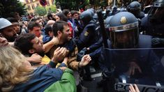 The police charging to prevent that people voted in l´Escola Industrial in Barcelona. The charges were unsuccesful people barricated inside the recinct.