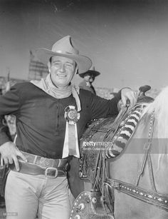 WORLD'S LARGEST 1-DAY RODEO - John Wayne served as Grand Marshal for this star-studded event - Sheriff's Rodeo - Los Angeles, CA - 1954.