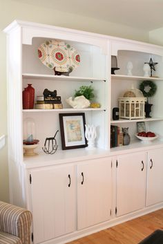 Built-In Bookcases - I like that these have cabinets too. Good place to hide stuff away - like toys for Jake.