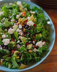 A simple kale salad gets a Southwestern twist with a homemade chile-lime vinaigrette, fresh corn, bell peppers, onion, black beans, avocado and queso fresco.