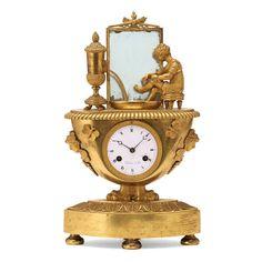 Relogio Frances Imperio do inicio do sec.19th em bronze gilded a ouro, 43cm de altura, 7,190 USD / 6,470 EUROS / 25,930 REAIS / 47,150 CHINESE YUAN soulcariocantiques.tictail.com