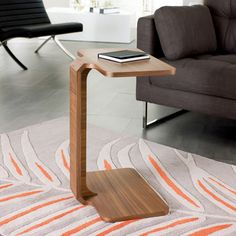 A side table that comes in handy for working or dining on your sofa, the Marcello makes an excellent surface area for over your lap.