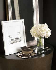 Suzie: Thom Filicia - Sleek demi-line table with silver leaf mirror, art in white gallery ...