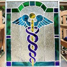 "Medical symbol stained glass panel - ""Don't let your ego write checks your brain can't back up."" You are in the right place about - Stained Glass Crafts, Faux Stained Glass, Stained Glass Panels, Stained Glass Patterns, Mosaic Glass, Fused Glass, Glass Art, Medical Symbols, Glass Photo"