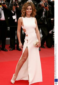 Cheryl Cole - Cheryl has an Angelina moment when she bares a thigh high split on the Cannes carpet.
