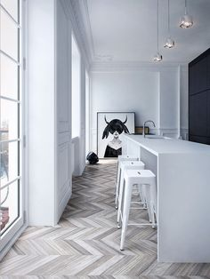 Interior MA by INT2 Architecture. Love the white color palette herringbone floor and Society6 art print. Great metal bar stools and floor to ceiling windows. #diningroom