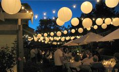 Attach strings between the trees and hang lots of Paper Lanterns – the effect is pretty and almost magical.