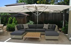 Outdoor Patio featuring furniture from Kingsley Bate, Gloster and Tucci (umbrella) located in Menlo Park, CA. Designed by Mini Irwin of Antiquarian Shop.