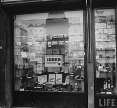 Window of shop owned by Jewish merchant. Sign reading JUDEN GESCHAFT (Jewish owned business),  sign required to be displayed by Nazi laws. Location: Linz Oberdonan, Germany 1938 Life Images