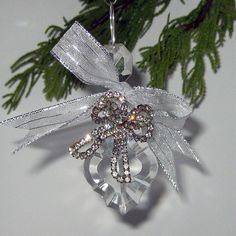 Here's a GREAT idea for reusing Grandma's jewelry. I could make ornaments for the grandkids.