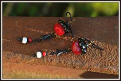 Red and Black Earrings with bronze fleur by practicallyfrivolous