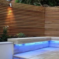 Beautiful Modern Contemporary Garden Fence using Western Red Cedar and downlighting. Great contrast with tiles and stonework. Garden designed by Blue Tulip Garden Design. Contemporary Fencing, Contemporary Landscape, Modern Contemporary, Fire Pit Area, Fire Pit Patio, Cedar Fence Boards, Trellis Fence, Modern Garden Design, Modern Design