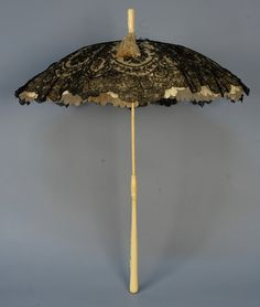 IVORY HANDLED FOLDING PARASOL with LACE CANOPY, 19th C.