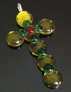 Yellow & Green Cross with Red Glass Center - Made from Glass Pebbles and Tac Fused with Glass Dots by goosecrossingfarm, $14.00  https://www.etsy.com/listing/194989887/yellow-green-cross-with-red-glass-center?