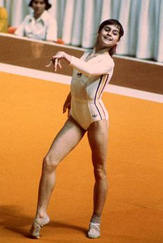 nadia comaneci. famous gymnast from romania. she had to leave her family at 14 but yet she still managed to become the greatest gymnast in the world. this is her famous pose from the 1976 olympics~inspiration