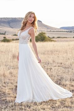This effortless and flowy bridal gown features everything from beautiful beading to a chiffon skirt that includes pockets! Swirls of beaded embroidery top the bodice of this A-line gown. Hijab Wedding Dresses, Wedding Dress With Veil, Dream Wedding Dresses, Bridal Dresses, Bridesmaid Dresses, Chiffon Dresses, Chiffon Skirt, Gown Gallery, Minimalist Wedding Dresses