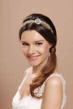 Wedding Hair Idea: a side ponytail accented with a Cheryl King Couture headband