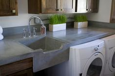 Concrete sink & counter top - What a perfect place to use concrete countertops = In the laundry room!