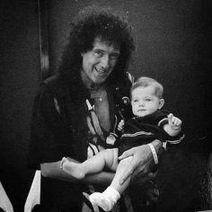 Brian May with John Deacon's son, Luke Deacon, circa 1993.