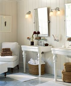 Love the dual pedestal sinks and ideas for wicker baskets