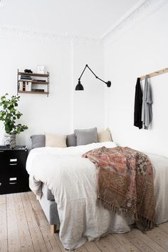 White minimal bedroom with black metal bedside table and light, wall hooks above bed and styled with greenery. Home Bedroom, Diy Bedroom Decor, Home Decor, Bedroom Ideas, Serene Bedroom, Bedrooms, Home Living, Apartment Living, Interior Exterior