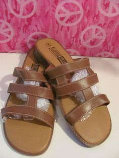 LEATHER CRAFT    WOMENS BROWN    SLIDE LEATHER SANDALS    SIZE 9.5M    BRAND NEW    1.5 IN HEEL    LIGHTLY PADDED INSOLE    BUCKLE ON TOP    VERY COMFY    SUPER CUTE    GREAT WITH JEANS OR SHORTS    WONDERFUL ADDITION    TO YOUR WARDROBE