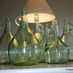 Turning Thrift Store Wine Bottles into Lamps.  Saw these at Home Goods store.