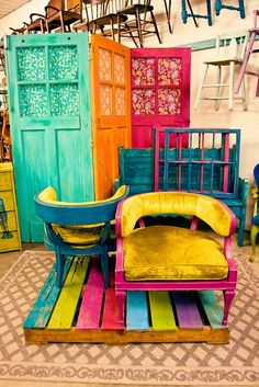 Use a painted pallet for an anchor for sale furniture... Three doors painted Booth121.com